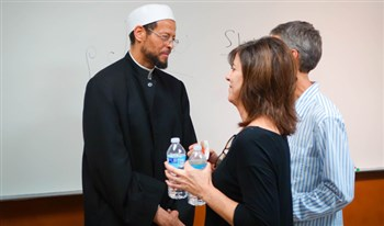 Imam Zaid Shakir greets visitors from St. Luke's UMC, Orlando, during their visit to the Islamic Center